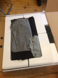 Image of clothes stuffed into computer packaging